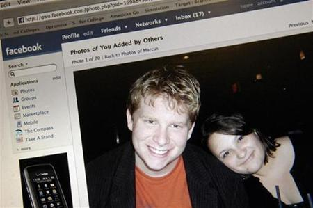 A photograph of Stephanie Endicott and Marcus Smallegan, first-year students at George Washington University, is seen on their Facebook website page in Washington November 25, 2007. Virtual beer and vampires may no longer be enough to keep members of social networks like Facebook and News Corp's MySpace riveted to their computers. REUTERS/Jonathan Ernst