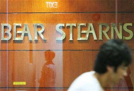 A man walks past the Bear Stearns office in Singapore March 17, 2008. REUTERS/Vivek Prakash