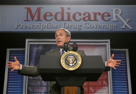 President George W. Bush speaks about the Medicare Prescription Drug Benefit in Sun City Center, Florida May 9, 2006 Medicare spending is increasing at such a fast pace that the president will be required to propose new benefit cuts or higher taxes, trustees for the U.S. senior citizen health care program said on Tuesday. REUTERS/Jason Reed