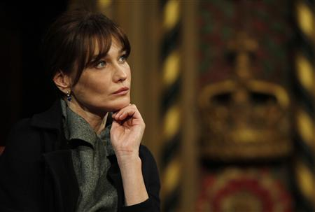 France's first lady Carla Bruni listens as her husband, French President Nicolas Sarkozy, addresses members of both Houses of Parliament in the Royal Gallery of the Palace of Westminster in London March 26, 2008. REUTERS/Stephen Hird