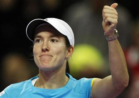 Belgium's Justine Henin celebrates victory over Bulgaria's Tsvetana Pironkova in the second round of the Proximus Diamond Games tennis tournament in Antwerp February 14, 2008. REUTERS/Thierry Roge