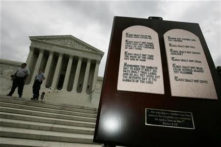 Tablets depicting the Ten Commandments placed outside the Supreme Court during a vigil by a religious group in a file photo. The division between church and state is a core principle of American democracy, but courts have long struggled to find exactly where the dividing line falls. REUTERS/Jason Reed