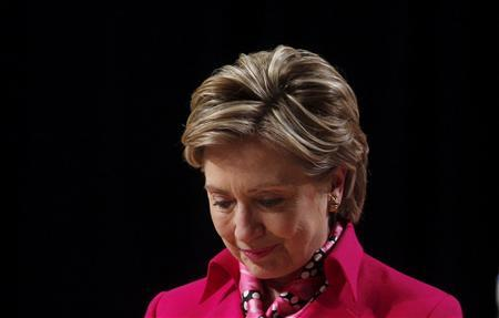 Democratic presidential candidate Senator Hillary Clinton (D-NY) listens to her introduction at a campaign fundraiser at Constitution Hall in Washington, March 26, 2008. REUTERS/Jim Young