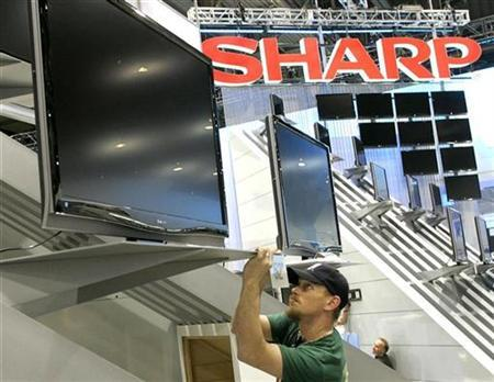 Aaron MacKendrick works on a display of Sharp flat panel televisions as exhibitors prepare for the Consumer Electronics Show (CES) at the Las Vegas Convention Center January 4, 2008. REUTERS/Las Vegas Sun/Steve Marcus