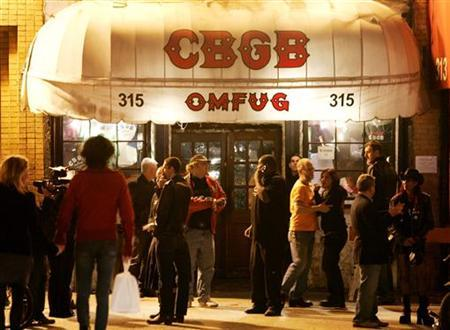 Patrons of the music venue CBGB are seen outside the club in New York City October 14, 2006. REUTERS/Lucas Jackson