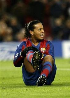 Barcelona's Ronaldinho sits on the pitch during their Champions League first knockout round, second leg football match against Celtic Glasgow at Nou Camp stadium in Barcelona March 4, 2008. Ronaldinho's time at Barcelona is at an end, according to the club's former coach Carles Rexach. REUTERS/Gustau Nacarino