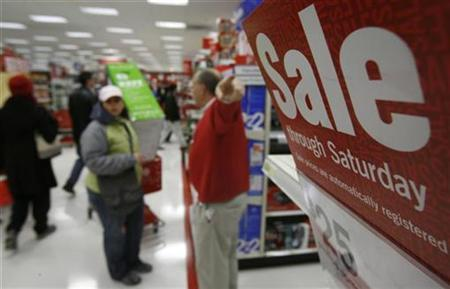 A man gestures to a ''Sale'' sign in a Target Store in Chicago November 23, 2007. REUTERS/John Gress