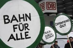 <p>Demonstrators hold banners during a protest against the proposed privatisation of German rail operator Deutsche Bahn in Berlin, March 28, 2008. REUTERS/Tobias Schwarz (GERMANY)</p>
