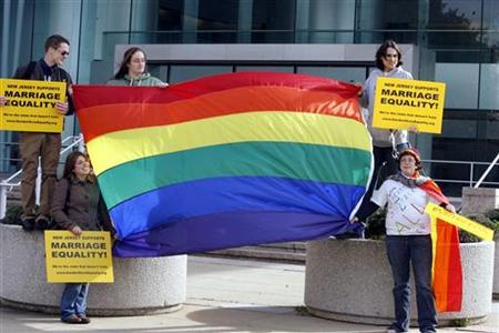 Supporters of gay marriage unfurl a rainbow flag before hearing the New Jersey Supreme court decision on same-sex marriage in front of the Supreme court building in Trenton, New Jersey, October 25, 2006. When Americans cast ballots on November 4 to elect a president, some states also will ask voters hot-button questions like whether or not to ban gay marriage. REUTERS/Tim Shaffer