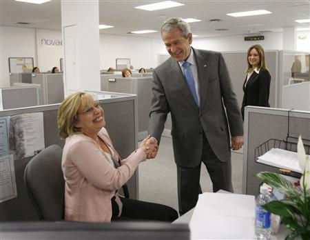 U.S. President George W. Bush greets Diane Suikowski, a client care specialist at Novadebt, a consumer debt counseling center in Freehold, New Jersey March 28, 2008. Bush made a statement on the housing crisis during his visit to the company. REUTERS/Jason Reed