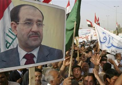 Demonstrators carry a picture of Iraqi Prime Minister Nuri al-Maliki during a protest in Kerbala March 28, 2008. REUTERS/Mushtaq Muhammed
