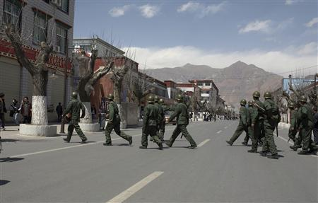 Chinese riot police patrol the streets in Lhasa, Tibet March 29, 2008. REUTERS/Stringer