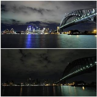 This combination of two images of the Sydney skyline were photographed at 8:20pm on March 28, 2008 (top) and during earth hour at 8:20pm on March 29, 2008. Thousands of lights that illuminate office buildings, public structures and monuments were switched off Saturday evening, darkening the city's iconic skyline for one hour, in an effort to publicise the effects of climate change. REUTERS/Tim Wimborne
