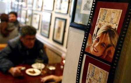 Customers are seen inside Cafe Diana in central London March 31, 2008. In the years since her death, Cafe Diana, its walls plastered with photographs of the princess and letters from her to the proud owner, has become a pilgrimage spot for tourists who hanker after the ''queen of hearts''. A coroner said on Monday there was no evidence that Prince Philip ordered the ''execution'' of Princess Diana in a 1997 car crash, dismissing the conspiracy theories of her late lover's father. REUTERS/Alessia Pierdomenico (BRITAIN)