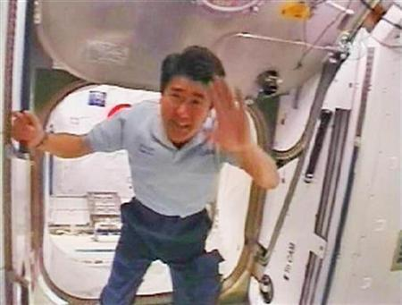 Japan Aerospace Exploration Agency astronaut Takao Doi waves from iinside the new Kibo module of the International Space Station after giving Japanese Prime Minister Yasuo Fukuda a video tour of the new addition to the ISS in this image from NASA TV March 19, 2008. REUTERS/NASA TV
