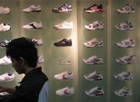A sneaker store in China's southern city of Guangzhou February 17, 2008. A recent poll has found that people who buy three pairs of sneakers or more a year are far more likely to be a leadership type that other people. REUTERS/Joseph Chaney