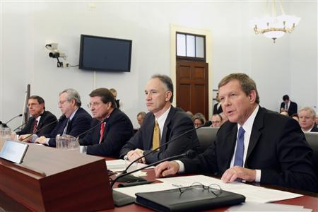 Robert Malone (R), Chairman and President of BP America speaks among four other oil company executives at a hearing on Capitol Hill in Washington, April 1, 2008. The executives (L-R), Senior Vice President of Exxon Mobil Stephen Simon, President of Shell Oil John Hofmeister, Vice Chairman of Chevron Peter Robertson and Executive Vice President of ConocoPhillips John Lowe joined Malone in testimony at the House select committee hearing on energy independence and global warming. REUTERS/Jason Reed