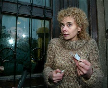 Yelena Tregubova, a Russian journalist and author of the book ''Tales of a Kremlin Digger'', is seen in Moscow, February 2, 2004. REUTERS/Sergei Karpukhin