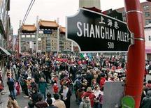 <p>Thousands gather on the streets of historic Chinatown in Vancouver, British Columbia January 29, 2006, to watch the annual Chinese New Year Parade. REUTERS/Andy Clark</p>