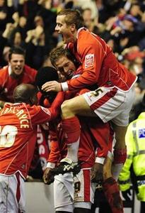 Barnsley's Kayode Odejayi (2nd L) celebrates scoring against Chelsea with his team mates during their FA Cup quarter-final football match at Oakwell in Barnsley, northern England, March 8, 2008. Opportunities to reach an FA Cup final do not come around often, especially for the likes of Portsmouth, West Bromwich Albion, Cardiff City and Barnsley who will be battling out this weekend's semi-finals at Wembley. REUTERS/Nigel Roddis