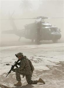 A U.S. soldier guards a helicopter in Mussayab, a predominately Shi'ite neighbourhood south of Baghdad, April 2, 2008. REUTERS/Ceerwan Aziz