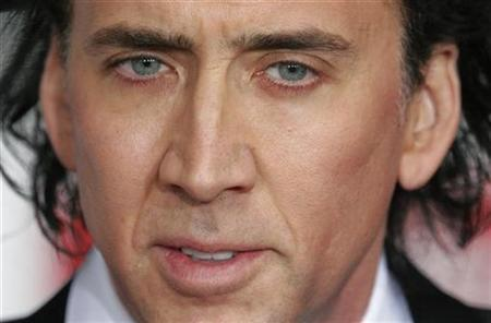 Nicolas Cage in Berlin, February 1, 2007. Cage on Friday won an apology and damages from actress Kathleen Turner over claims in her autobiography that he had been arrested twice for drunk driving and had once stolen a Chihuahua. REUTERS/Hannibal Hanschke