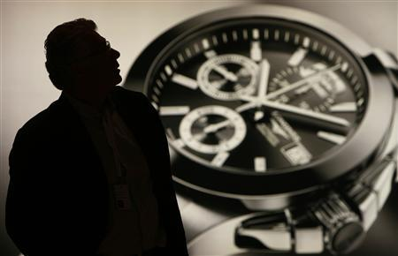 A man visits the Swatch Group showcase during press day at Baselworld in Basel April 2, 2008. REUTERS/Christian Hartmann