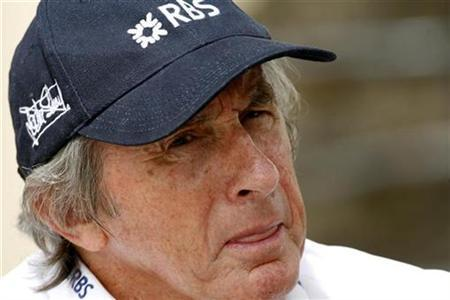Former Formula One driver Jackie Stewart speaks with a television reporter in the paddock during the first practice session ahead of the Bahrain F1 Grand Prix April 4, 2008. REUTERS/Caren Firouz