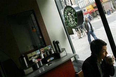 A customer sits in a Starbucks coffee shop in New York, March 14, 2007. REUTERS/Keith Bedford