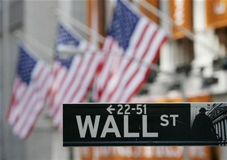 File photo shows the Wall Street street sign outside the New York Stock Exchange in New York February 28, 2007. REUTERS/Shannon Stapleton