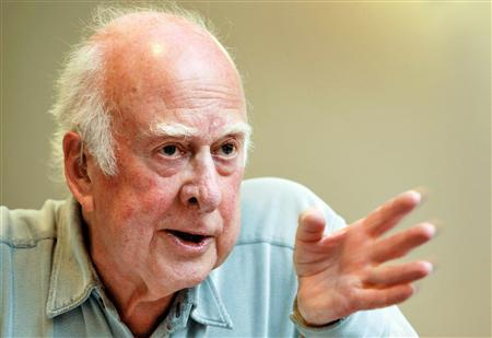 British physicist Peter Higgs gestures during a press conference on the sideline of his visit to the European Organization for Nuclear Research (CERN) in Geneva, April 7, 2008. Higgs said on Monday he expects proof will be found soon of an all-pervading force giving mass to the universe and making life possible - existence of which he predicted over 40 years ago. REUTERS/Fabrice Coffrini/Pool