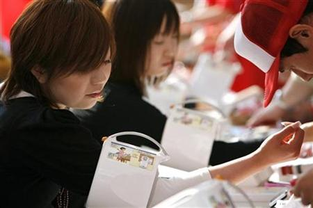 A woman has her blood pressure taken at a World Hypertension Day event at Chiba Marine Stadium in Chiba, east of Tokyo, May 17, 2007. REUTERS/Kiyoshi Ota