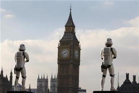 Two life-size figures of Star Wars 'Stormtrooper' characters, promoting an exhibition of the film series, are seen near the Houses of Parliament and Big Ben clock tower in central London October 19, 2007. REUTERS/Toby Melville