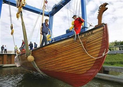 A replica Viking ship made by Robert McDonald of the U.S. from 15 million ice-cream sticks is launched for a test sail on the Markermeer in Lelystad July 13, 2007. REUTERS/Robin van Lonkhuijsen