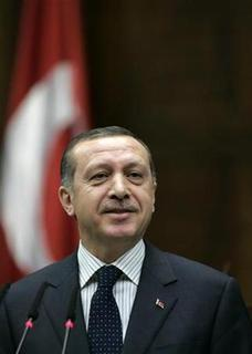 Turkey's Prime Minister Tayyip Erdogan addresses MPs from his ruling Ak Party (AKP) during a meeting at the Turkish parliament in Ankara April 1, 2008. TEUTERS/Umit Bektas