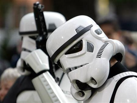 Star Wars fans dressed as Stormtroopers gather in Leicester Square as they wait for the premier of the new film ''Episode II Attack of the Clones'' in London May 14, 2002. REUTERS/Ian Waldie