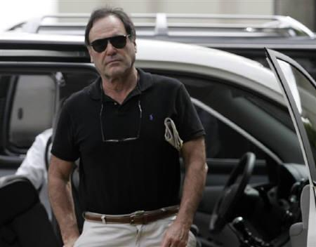U.S. film director Oliver Stone arrives at Apiay military base in Villavicencio December 31, 2007. REUTERS/Carlos Duran