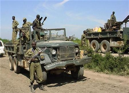 Soldiers loyal to the Somali government ride on military vehicles near the town of Jowhar December 27, 2006. Islamist fighters in Somalia seized Jowhar, north of Mogadishu, on Wednesday for the second time in a fortnight, a spokesman for the insurgents said. REUTERS/Stringer