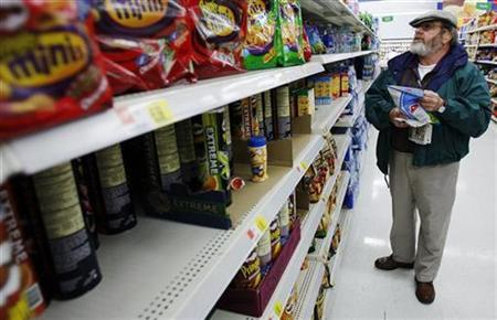 A man picks out a bag of chips while grocery shopping at the Wal-Mart in Crossville, Tennessee March 21, 2008. REUTERS/Brian Snyder