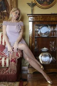 Italian porn star Milly D'Abbraccio poses in her home during an interview in Rome April 10, 2008. REUTERS/Max Rossi
