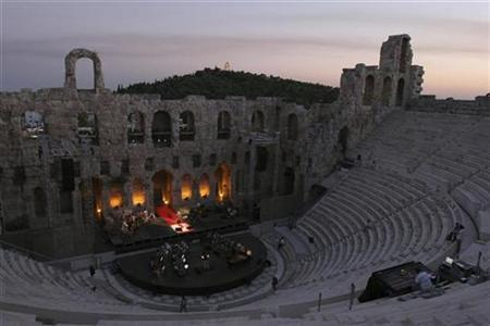 Lebanese diva Fairuz rehearses at the ancient Odeon of Herodes Atticus in Athens in the early hours of July 7, 2007. REUTERS/Hasan Mroue/Handout