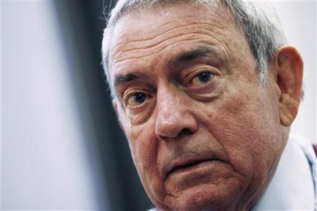 Television news anchor Dan Rather speaks during an interview in New York, November 7, 2006. REUTERS/Keith Bedford