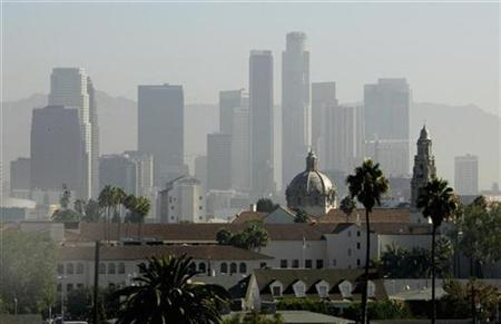 The skyline of downtown Los Angeles is pictured September 12, 2007 with haze obscuring the skyscrapers in this photograph taken from the roof of a parking garage near the campus of the University of Southern California. REUTERS/Fred Prouser