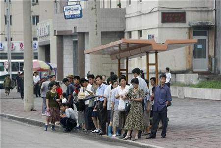 North Koreans wait at a bus stop in Pyongyang, August 27, 2007. Impoverished North Korea is seeking international aid to battle one of its worst food shortfalls in years, a senior U.N. official based in Asia said on Friday. REUTERS/Reinhard Krause