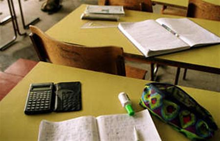 Undated file photo shows student desks in a school. CCTV cameras could be used in school exam halls in an attempt to prevent cheats using increasingly high-tech devices, examiners said on Friday. REUTERS/file