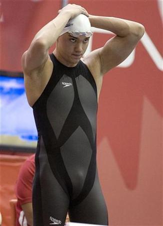 Joel Greenshields adjusts his cap as he participates in the 400m Medley Relay timed trial wearing his new Speedo LZR suit at the Canadian Olympic swimming trials in Montreal April 6, 2008. REUTERS/ Christinne Muschi