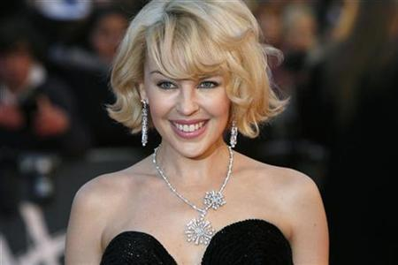Singer Kylie Minogue arrives for the Brit Awards at Earls Court in London February 20, 2008. REUTERS/Luke MacGregor