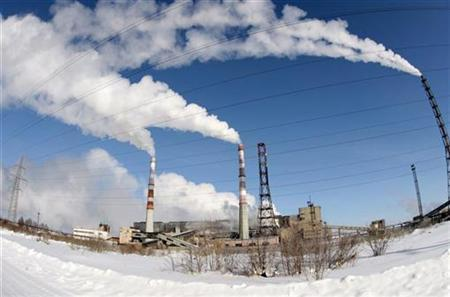 Steam rises from chimneys of the pulp mill on the shore of Lake Baikal 180 km (112 miles) southeast from the regional centre Irkutsk in this February 3, 2008 file photo. Six campaigners who took on governments and multi-national corporations from Russia to Ecuador and won have been rewarded with this year's Goldman Environmental Prizes. REUTERS/Tatyana Makeyeva/Files