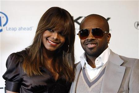 Janet Jackson and Jermaine Dupri attend a benefit at the Esquire House 360 in Beverly Hills November 1, 2006. Consumer products giant Procter & Gamble is getting into the hip-hop business by launching a record label with Island Def Jam Music Group, to be run by Dupri. REUTERS/Mario Anzuoni