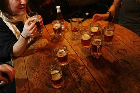 A round of beers sit on a table inside McSorley's Old Ale House in New York March 11, 2008. REUTERS/Lucas Jackson